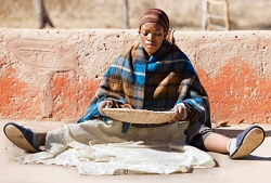 Woman Sifting Sorghum Seeds