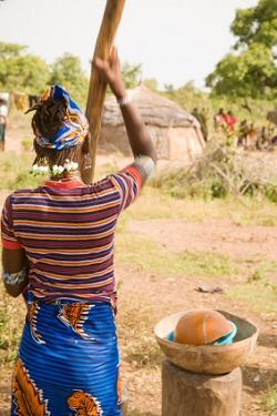 Fulani Woman Grinding Grain